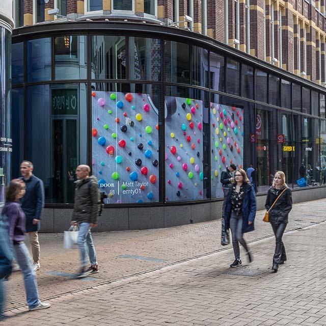 Digitaal scherm Amsterdam Kalverstraat Muntplein Ocean